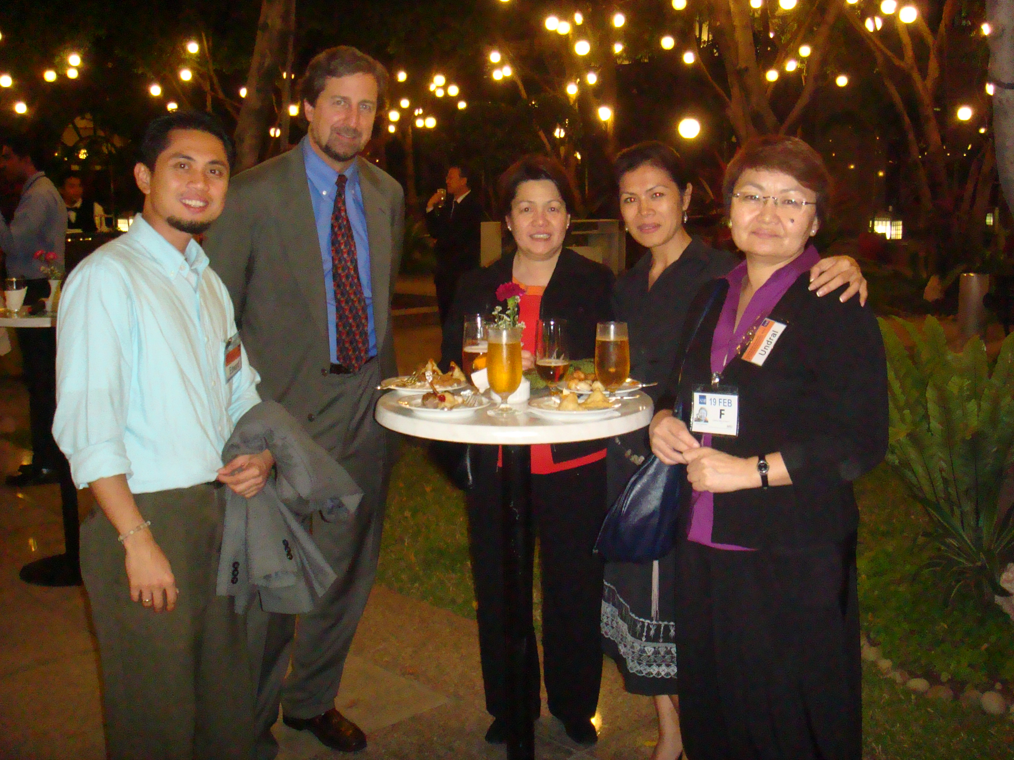 Theary Seng with Eric Henry, Helen Garcia, Edward Gacusana, Undral Gombodorj at reception ADB garden Manila, the Philippines, 17 Feb. 2010