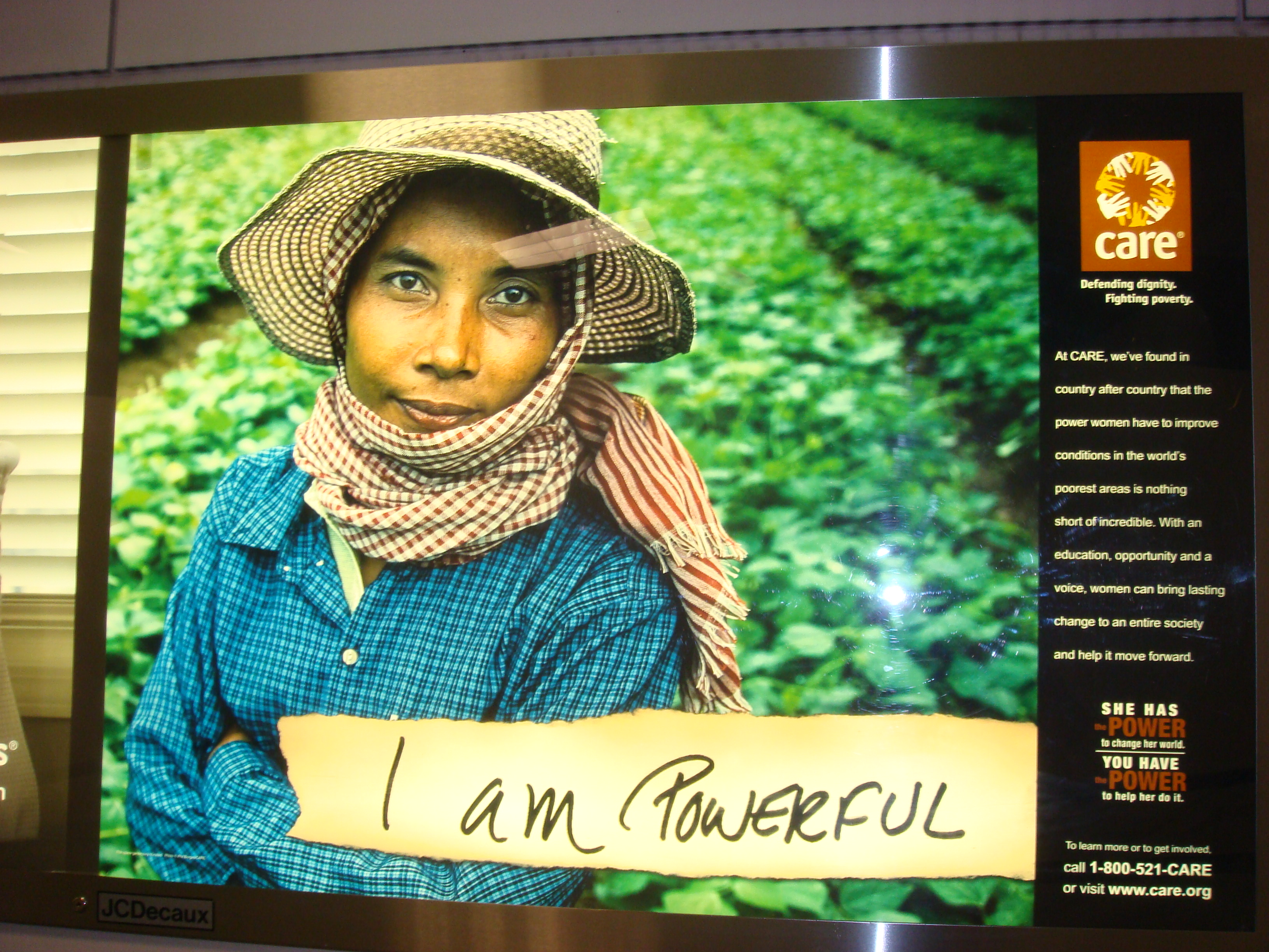 "CARE billboard of Khmer woman ""I am powerful"", Newark Intl Airport, May 2010"